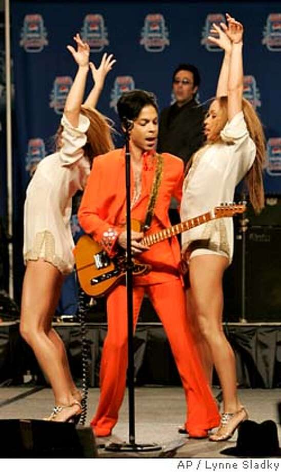 Super Bowl XLI halftime act Prince performs with his dancers during a press conference at the Miami Beach Convention Center in Miami Beach, Fla., Thursday, Feb. 1, 2007. (AP Photo/Lynne Sladky) Photo: Lynne Sladky