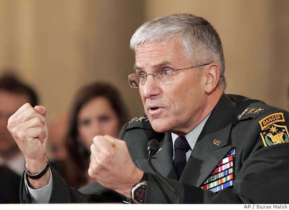 Gen. George W. Casey, Jr., answers a question during the Senate Armed Services committee hearing on Capitol Hill in Washington, Thursday, Feb. 1, 2007, on his nomination to become Army Chief of Staff. (AP Photo/Susan Walsh) Photo: SUSAN WALSH