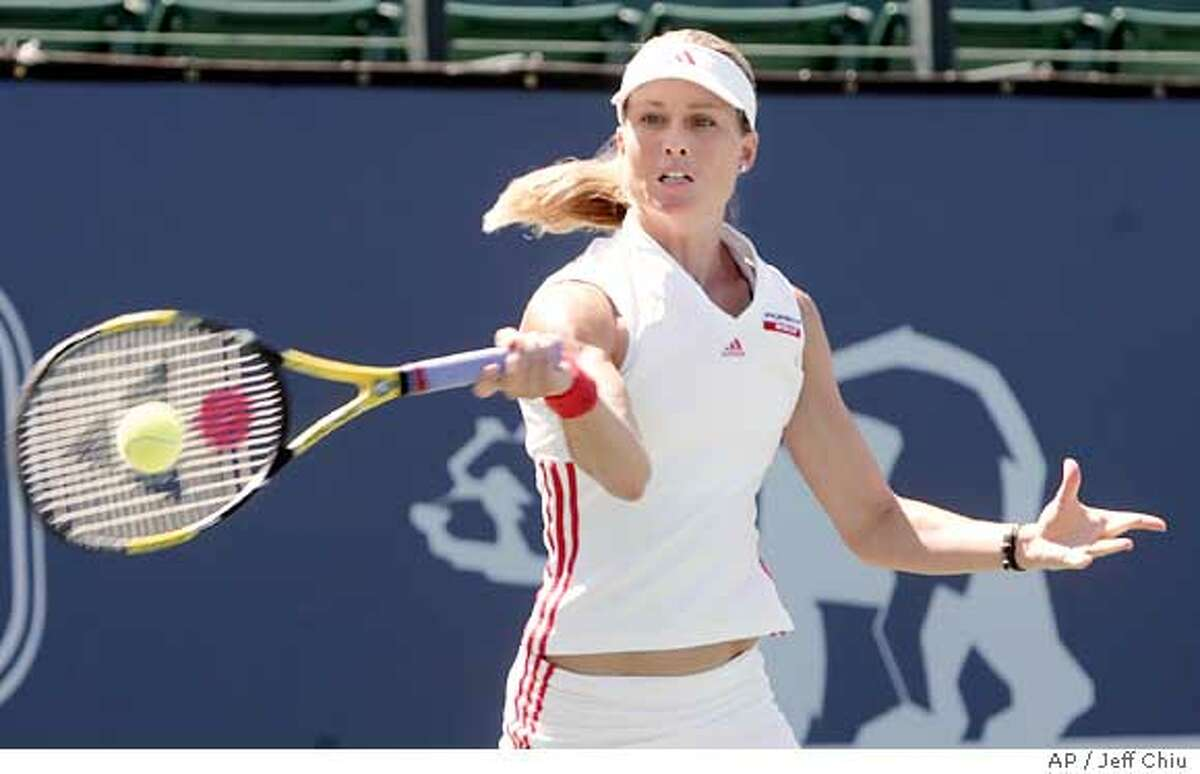Meghann Shaghnessy hits a shot in the first set against Vera Zvonareva in their second round match in the Classic in Stanford, Calif., Tuesday, July 26, 2005. Shaughnessy won 6-3, 1-6, 7-6 (8-6). (AP Photo/Jeff Chiu)