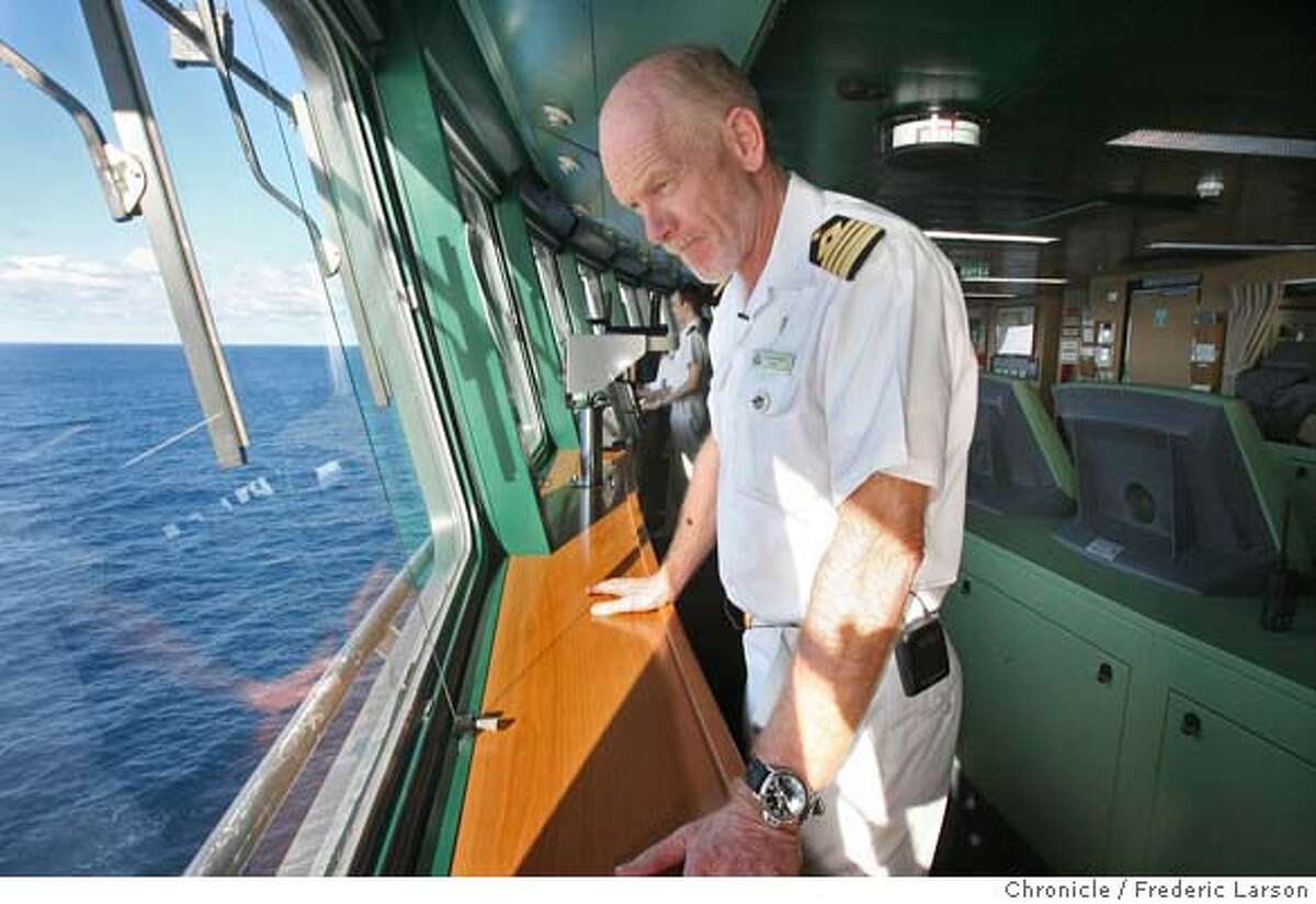 Captain Christopher Rynd (cq) standing on the bridge of the Queen Mary 2 is in command of the grandest ocean liner ever built that will stop in San Francisco on its maiden call under to the city February 4-5, 2007. In SF she will then still for a rare overnight visit, Queen Mary 2's arrival in the City by the Bay is cause for celebration, as the iconic ship -- which measures four times the height of San Francisco's famed Telegraph Hill and nearly 280 feet longer than the height of the Transamerica Pyramid -- will make this her only visit to the West Coast in 2007. (date} {Photographed by Frederic Larson} MANDATORY CREDIT FOR AND SAN FRANCISCO CHRONICLE/ -MAGS OUT