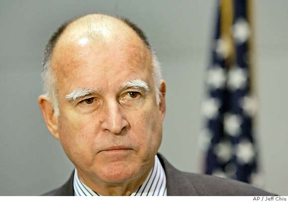 California Attorney General Jerry Brown speaks at a news conference in San Francisco, Thursday, Feb. 1, 2007. Brown said Thursday he will pursue a lawsuit against the six largest U.S. and Japanese automakers in which the state seeks millions of dollars in damages caused by vehicle emissions of greenhouse gases. (AP Photo/Jeff Chiu)