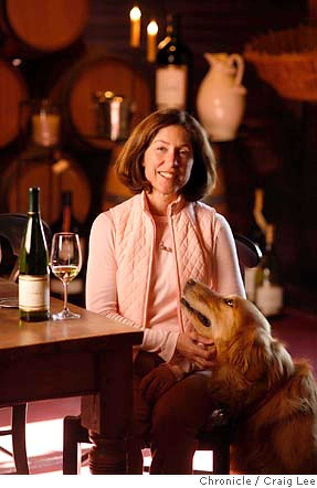 RIESLING02_298_cl.JPG Story on the resurgence of California riesling wine. Photo of Janet Trefethen of Trefethen vineyards, with her dog, Bella. Event on 1/23/07 in Napa. photo by Craig Lee / The Chronicle MANDATORY CREDIT FOR PHOTOG AND SF CHRONICLE/ -MAGS OUT