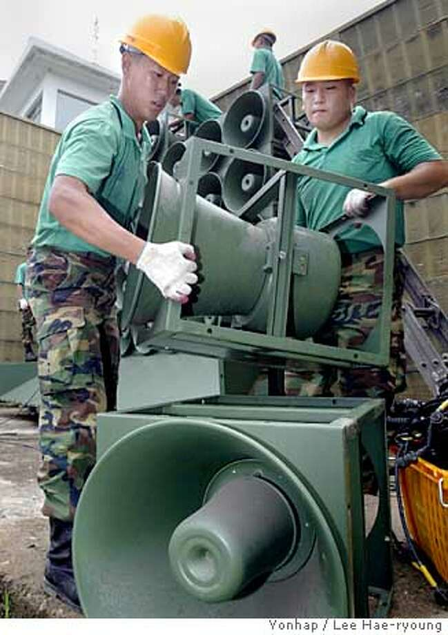 South Korean Army soldiers remove loudspeakers used to broadcast pro-South propaganda to North Korea near the demilitarized zone between the two Koreas in Hwacheon city, north of Seoul, Wednesday, July 27, 2005. Last year the two Koreas agreed to end propaganda broadcasts along their heavily militarized border as part of efforts to reduce tensions on their divided peninsula. (AP Photo/Yonhap, Lee Hae-ryoung) ** KOREA OUT ** Ran on: 07-28-2005  South Korean soldiers remove a loudspeaker used to beam propaganda to the north. Ran on: 07-28-2005 Photo: LEE HAE-RYOUNG