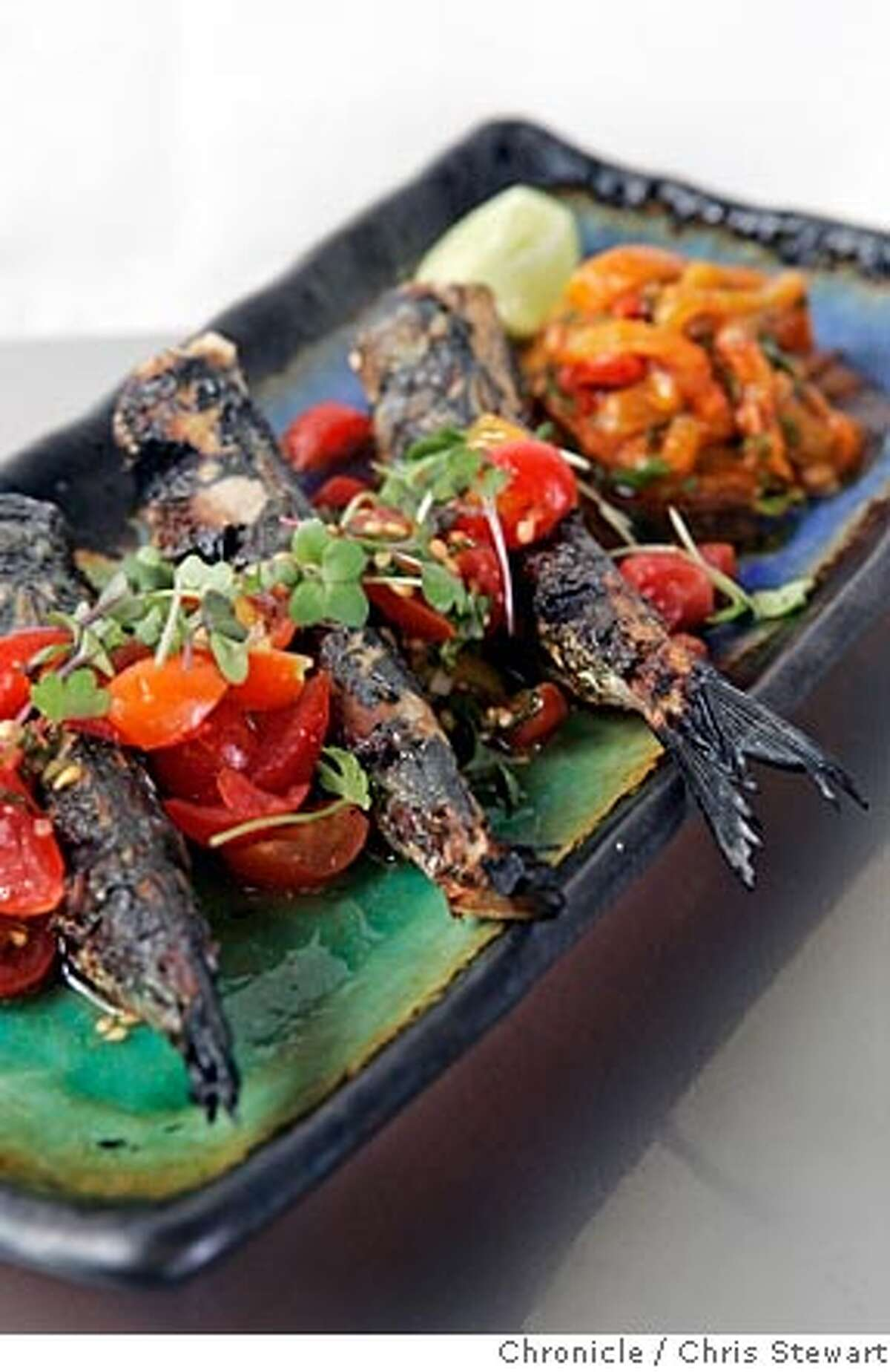 Event on 7/21/05 in Berkeley. A new restaurant in Berkeley called Sea Salt is featuring dishes such as the grilled local sardines with marinated roasted peppers and tomato-mint vinaigrette. The restaurant is located at 2512 San Pablo Avenue. Chris Stewart / The Chronicle