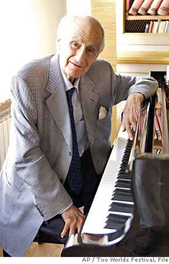 ** FILE ** This undated file photo released by Two Worlds Festival press office Wednesday July 6, 2005, shows composer Gian Carlo Menotti. Menotti, founder of Spoleto's festival in 1958, died Thursday, Feb. 1, 2007 at a hospital in Monaco, his son said, he was 95. (AP Photo/Two Worlds Festival press office/ho/files) PHOTO PROVIDED BY TWO WORLDS FESTIVAL PRESS OFFICE ON JULY 6, 2005 Photo: M