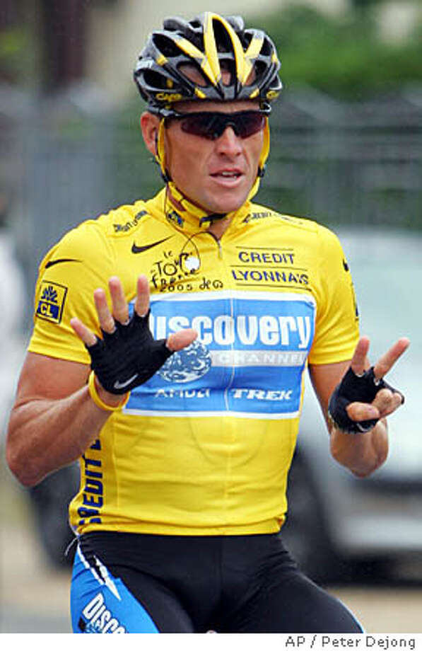 Overall leader Lance Armstrong, of Austin, Texas, signals seven for his seventh straight win in the Tour de France cycling race, as he rides during the 21st and final stage of the race between Corbeil-Essonnes, south of Paris, and the French capital, Sunday, July 24, 2005. (AP Photo/Peter Dejong) Photo: PETER DEJONG