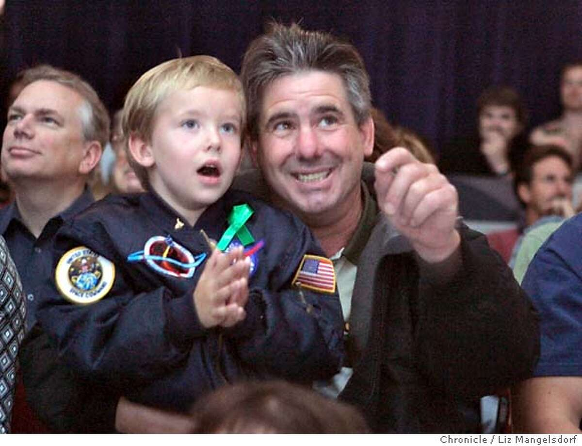 Event on 7/26/05 in Mountain View. Nasa Ames visitors and shuttle fans Joshua Mutto, 5, and his father Gregory Mutto, from Half Moon Bay, watch the shuttle launch at Nasa Ames Research Center. Nasa Ames employees and visitors watch the space shuttle launch Tuesday morning. Liz Mangelsdorf / The Chronicle