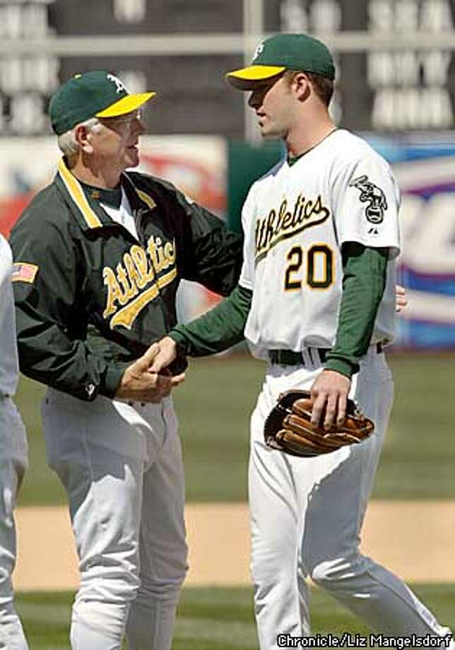Event on 4/24/03 in Oakland. LIZ MANGELSDORF / The Chronicle  Mark Mulder is congratulated by the a's Manager Ken Macha after the game. OAKLAND ATHLETICS BEAT THE DETROIT TIGERS 2-0. A'S MARK MULDER PITCHES A SHUTOUT. Photo: LIZ MANGELSDORF