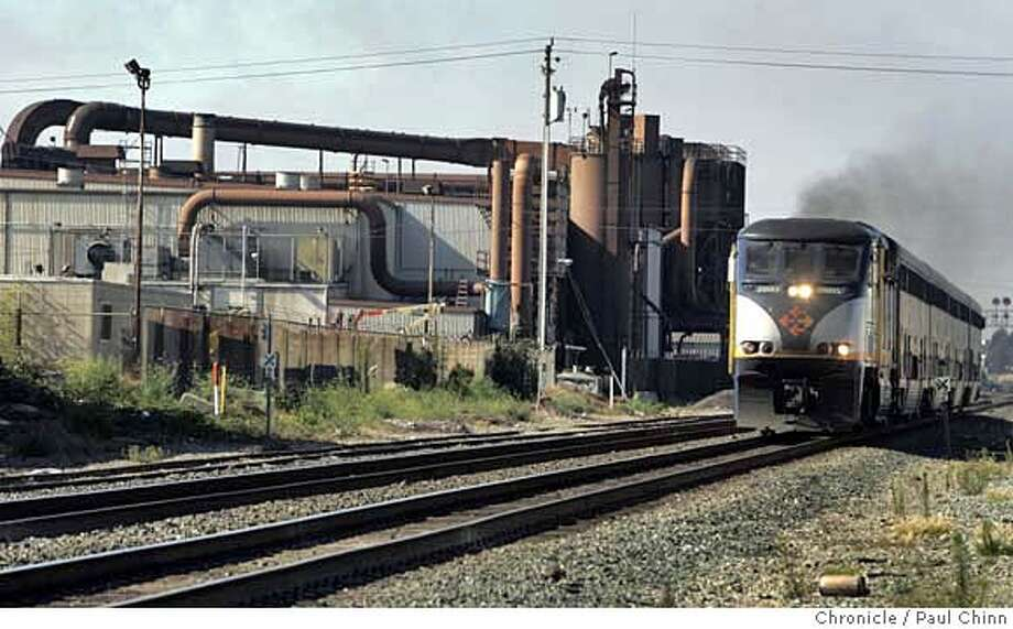 An Amtrak train rolls past the Pacific Steel foundry in Berkeley, Calif. on Wednesday, September 13, 2006. The third-largest steel mill in the country was slapped with two lawsuits seeking to curb the acrid smell that's emitted from the plant.  PAUL CHINN/The Chronicle MANDATORY CREDIT FOR PHOTOGRAPHER AND S.F. CHRONICLE/ - MAGS OUT Photo: PAUL CHINN