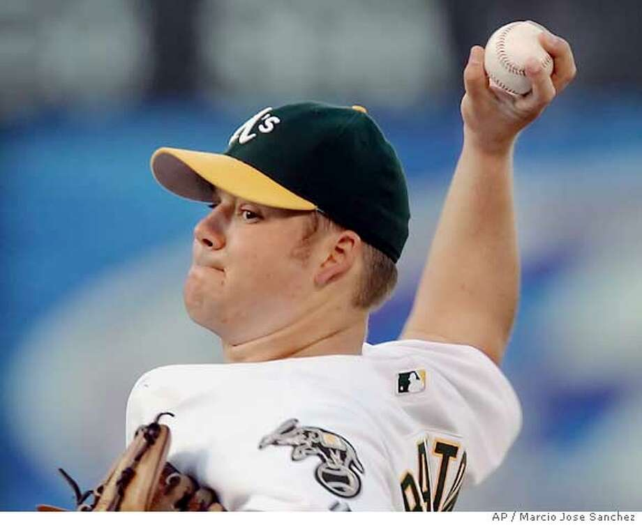 Oakland Athletics starter Joe Blanton throws to the Cleveland Indians in the first inning on Tuesday, July 26, 2005 in Oakland, Calif. (AP Photo/Marcio Jose Sanchez) Photo: MARCIO JOSE SANCHEZ