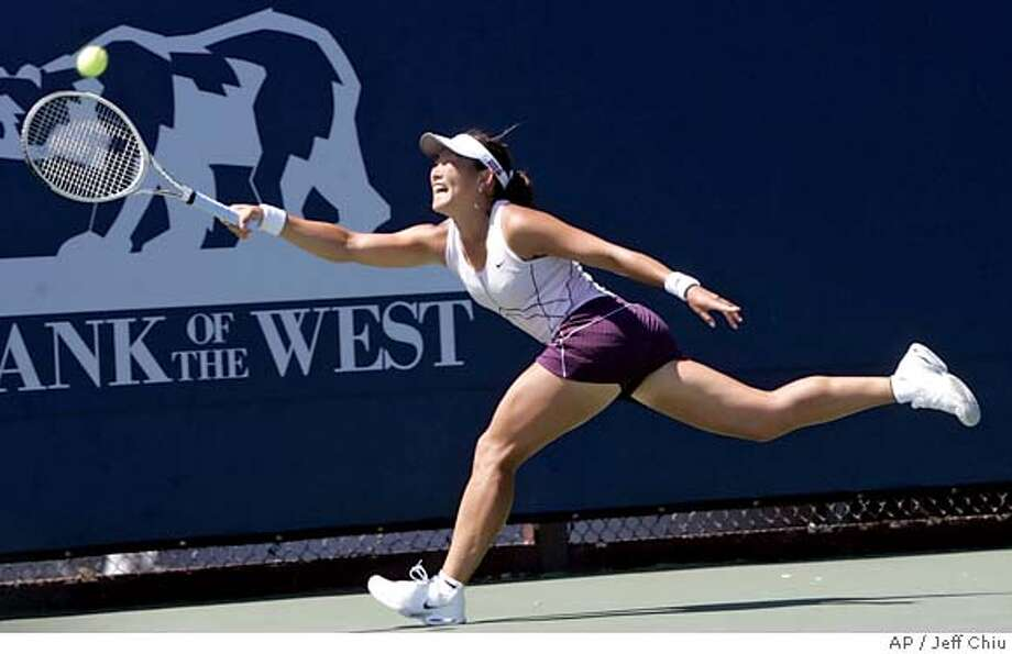 Ai Sugiyama, of Japan, reaches for the ball in the first set against Samantha Stosur, of Australia, during their first-round match in the Bank of the West Classic in Stanford, Calif., Monday, July 25, 2005. Sugiyama won 7-6 (12-10), 6-2. (AP Photo/Jeff Chiu) Photo: JEFF CHIU