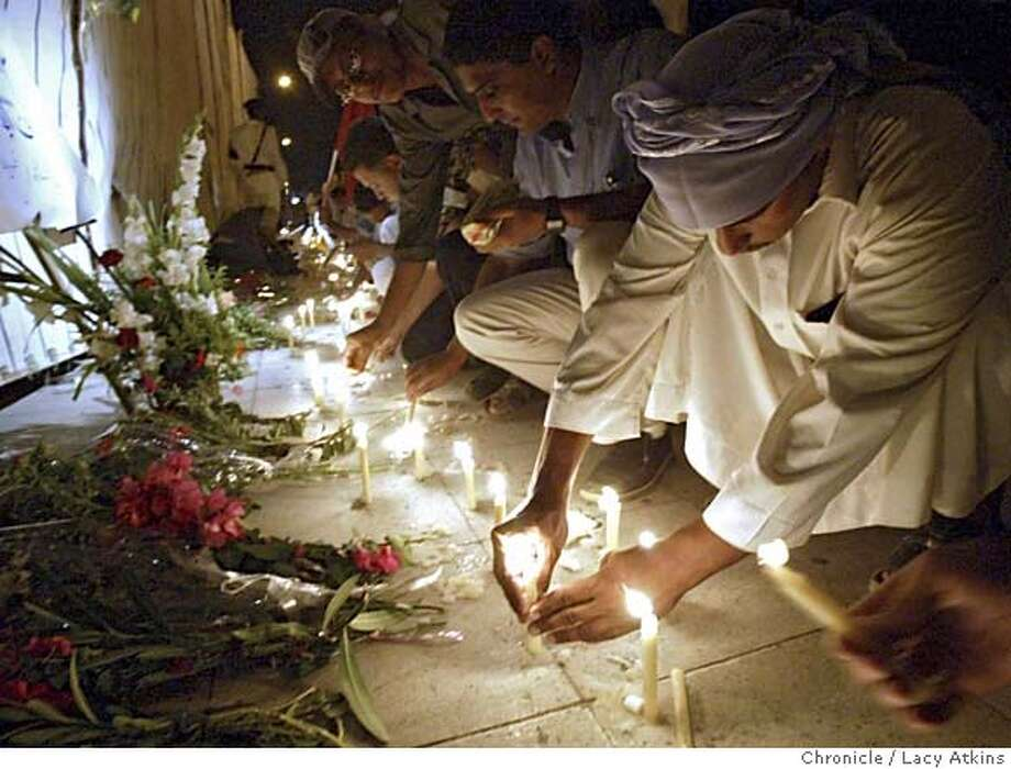 """Approximately two thousand people gather outside The Ghazala Garden Hotel, Sunday July 24, 2005, to light candles and protest """"No More Terrorism"""".The Ghazala Garden Hotel was among the three bombing that ripped through the Egyptian Red Sea resort of Sharm el-Sheik early Saturday killing at least 83.Photo By Lacy Atkins Photo: LACY ATKINS"""