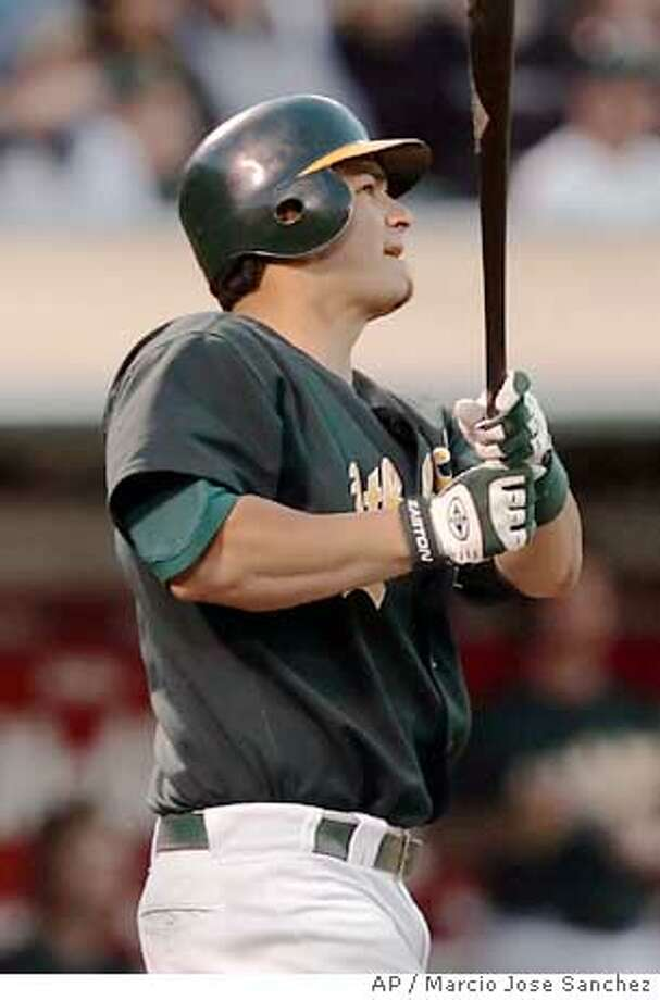 Oakland Athletics' Eric Chavez watches the flight of his two-run home run off Cleveland Indians reliever Rafael Betancourt in the fourth inning on Monday, July 25, 2005 in Oakland, Calif. (AP Photo/Marcio Jose Sanchez) Photo: MARCIO JOSE SANCHEZ