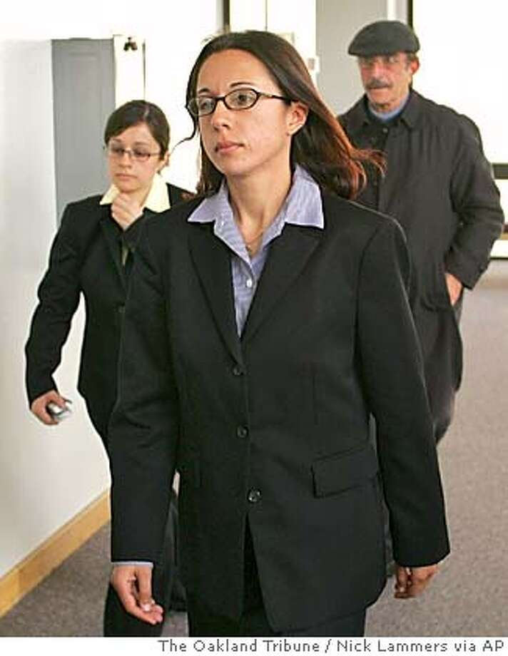 Hamaseh Kianfar leaves Alameda County Superior Court, Thursday, April 7, 2005, in Oakland, Calif. after an arraignment on the accessory to attempted murder charge in the recent Berkeley throat slashing case. Kianfar is a mental health worker in Alameda County Juvenile Hall who authorities say was with Marilyn Webster, 16, when she slashed an elderly woman in the Berkeley Hills in March. (AP Photo/Nick Lammers/The Oakland Tribune) Photo: NICK LAMMERS