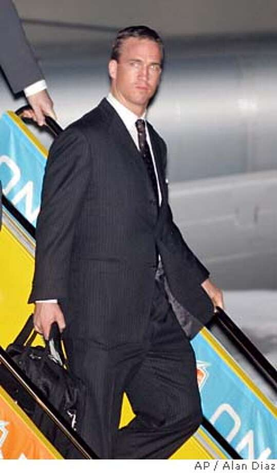 Indianapolis Colts football quarterback Peyton Manning arrives at Fort Lauderdale-Hollywood International Airport in Fort Lauderdale, Fla., Monday, Jan. 29, 2007. The Colts will play the Chicago Bears in The Super Bowl Sunday in Miami.(AP Photo/Alan Diaz) Photo: Alan Diaz