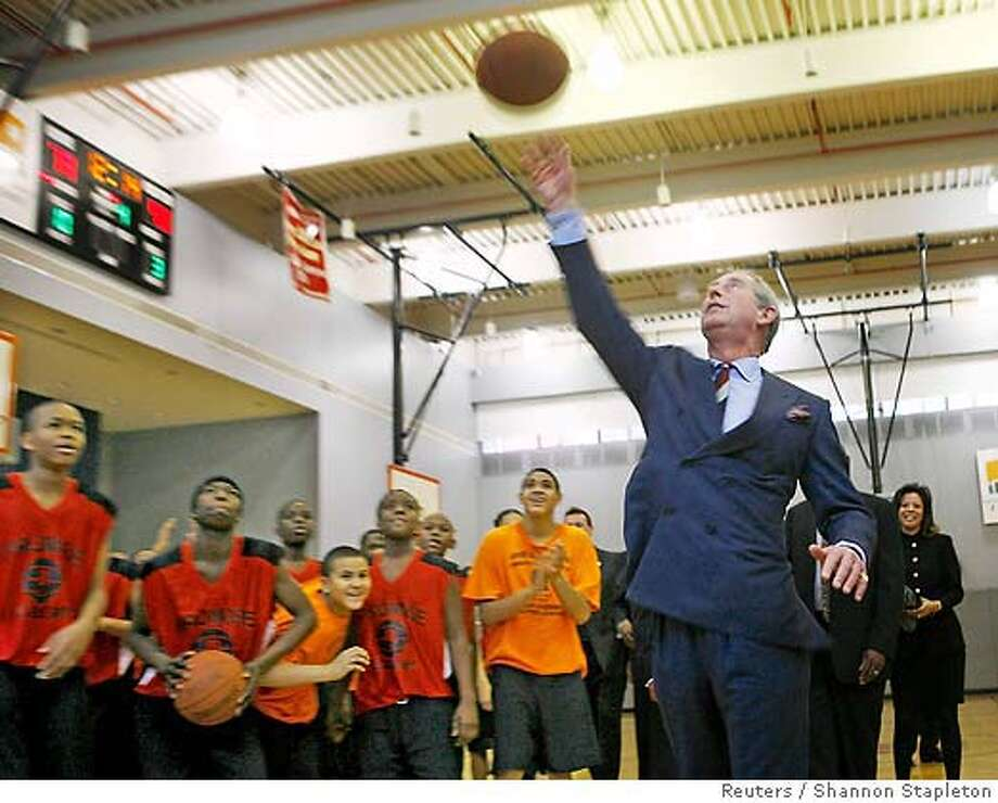 Britain's Prince Charles attempts to shoot basketball at the Harlem Children's Zone in New York Photo: SHANNON STAPLETON