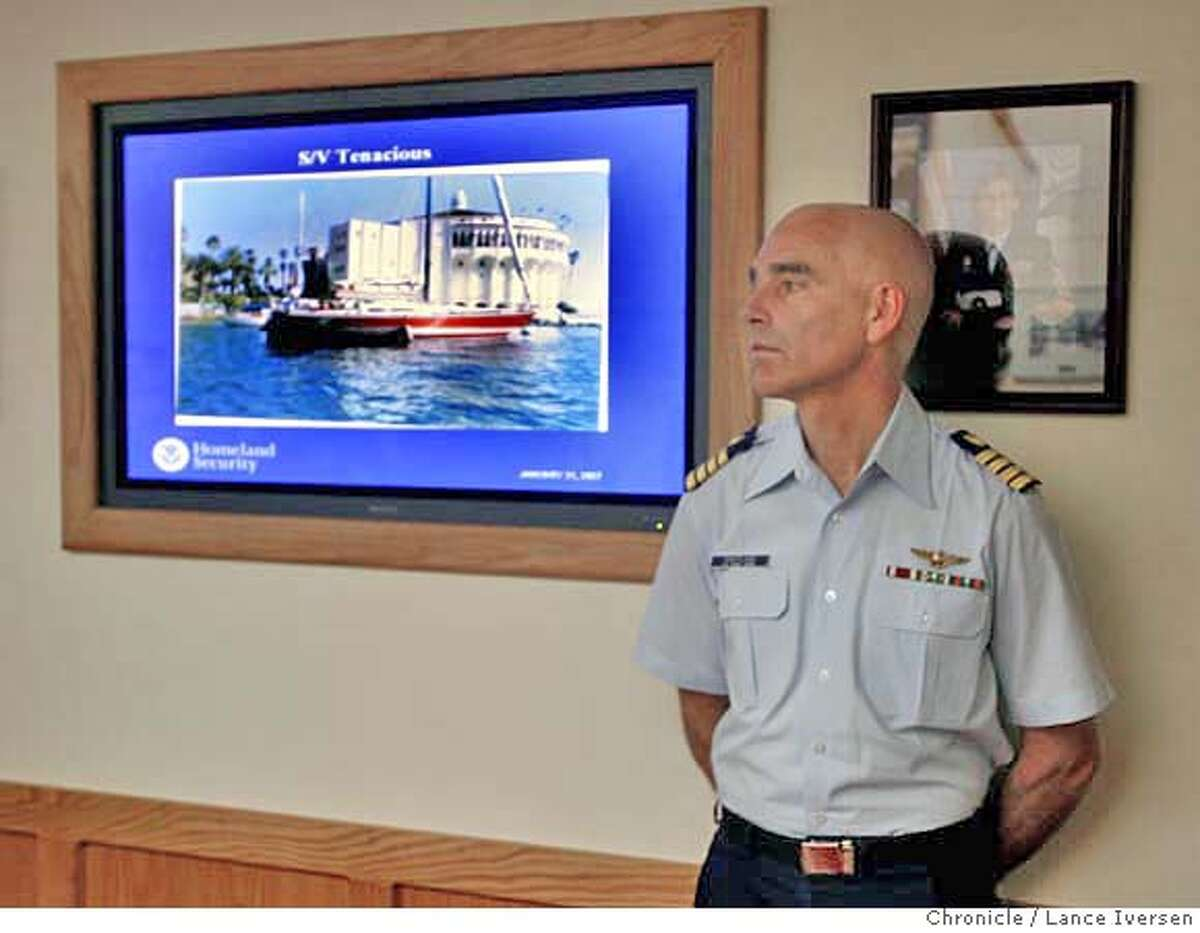 MISSING01_4427.JPG US Coast Gurad Captain David Swatland, Deputy Sector Commander spoke to the Media during a slide show that offered a new photo of vessel