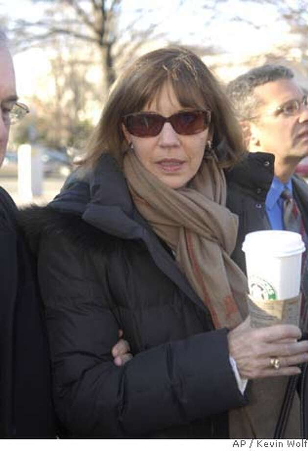 Former New York Times journalist Judith Miller arrives to U.S. District Court in Washington, Tuesday, Jan.. 30, 2007, with members of her legal team. (AP Photo/Kevin Wolf) Photo: KEVIN WOLF