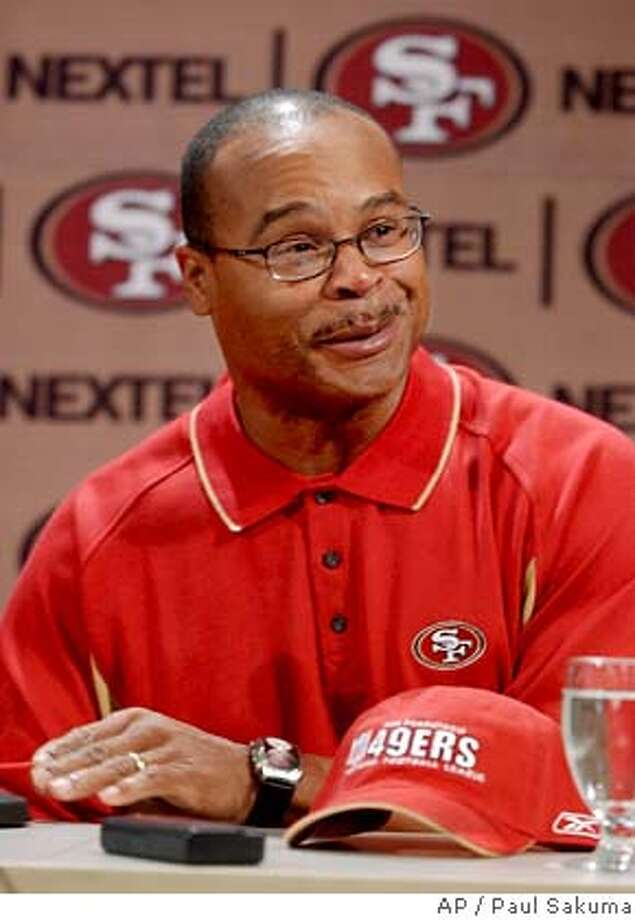 New San Francisco 49ers assistant head coach and linebackers coach Mike Singletary smiles at a news conference at 49ers headquarters in Santa Clara, Calif., Friday, Jan. 21, 2005. Singletary coached with 49ers head coach Mike Nolan for the previous two seasons as the Baltimore Ravens inside linebackers coach. (AP Photo/Paul Sakuma) Ran on: 01-22-2005  Mike Singletary captured Mike Nolan's attention during his stint on the staff of the Baltimore Ravens. Photo: PAUL SAKUMA