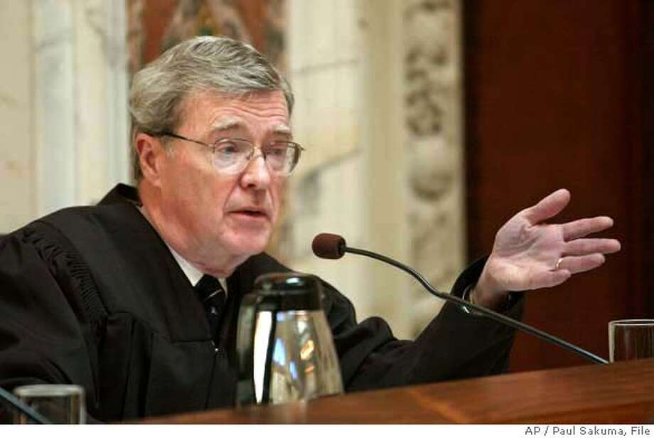 Judge Diarmuid F. O'Scannlain, of the 9th U.S. Circuit Court of Appeals, gestures during oral arguments in a San Francisco courtroom, Monday, Sept. 22, 2003. The 11 federal judges could decide the date of the California's on-again, off-again recall election during a hearing on Monday. (AP Photo/Paul Sakuma) POOL PHOTO Photo: PAUL SAKUMA
