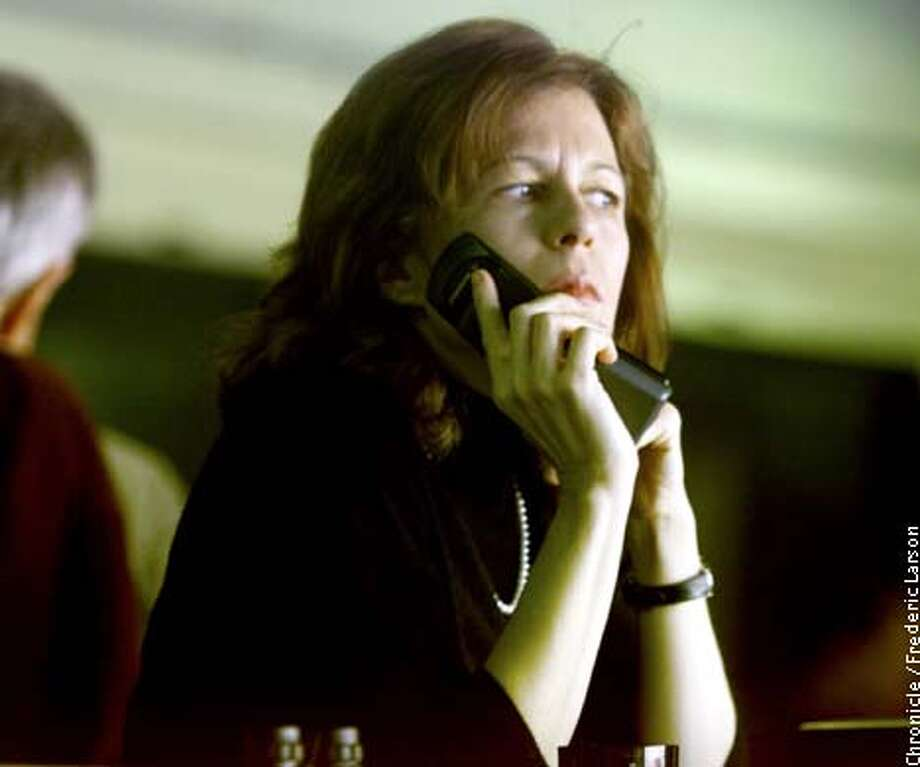 : Raiders exec Amy Trask talks on the phone in the press box at Three Rivers Stadium in Pittsburg where the Raiders played the Steelers. She's the highest ranking female executive in the NFL. Chronicle photo by Frederic Larson Photo: FREDERIC LARSON