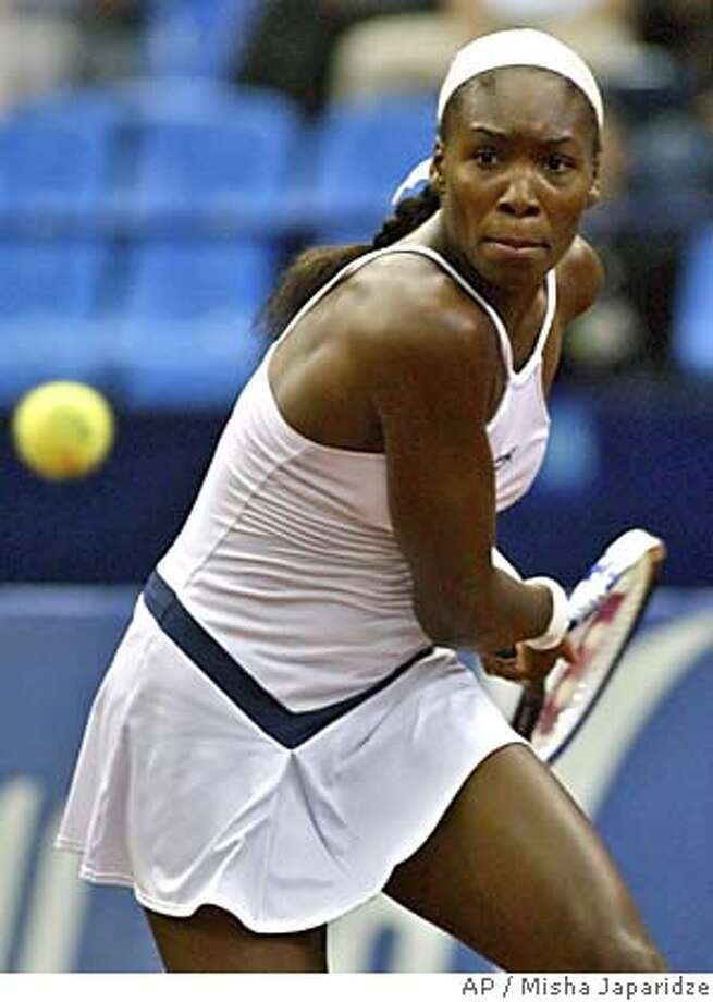 Venus Williams, of the U.S., returns a shot during her semifinal match against Elena Dementieva, of Russia, at the Fed Cup tennis tournament in Moscow's Olympic Indoor stadium, Sunday, July 10, 2005. Williams won 6-1, 6-2. (AP Photo/Misha Japaridze) Photo: MISHA JAPARIDZE