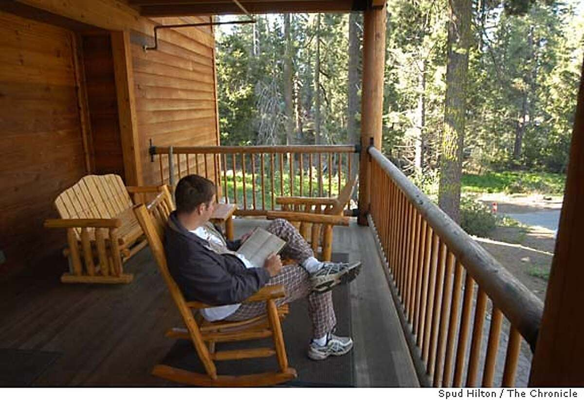 A guest relaxes on the porch of Muir Lodge, a western style lodge with modern amenities, in Grant Grove Village in Kings Canyon National Park. The lodge was built in 2000. Kings Canyon National Park on 6/14/05.