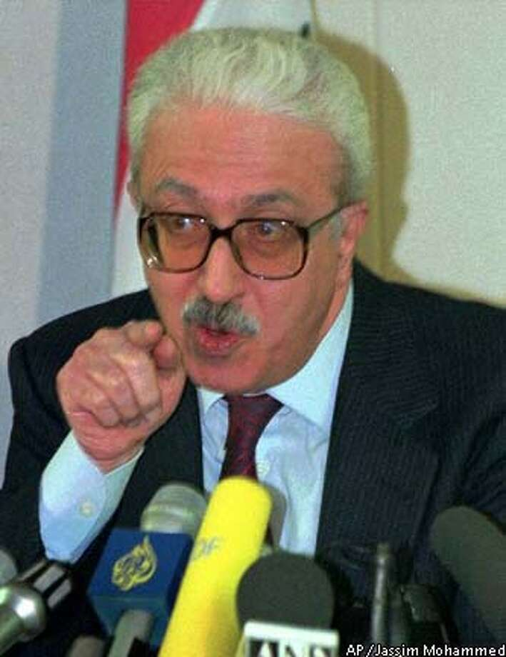 Iraq's deputy premier, Tariq Aziz, speaks to journalists on Wednesday, Jan, 21, 1998 during a press conference in Baghdad. Aziz said that he is confident the assessment meetings on Iraq's disarmament could lead to a lifting of the economic sanctions on his country. (AP Photo/Jassim Mohammed)