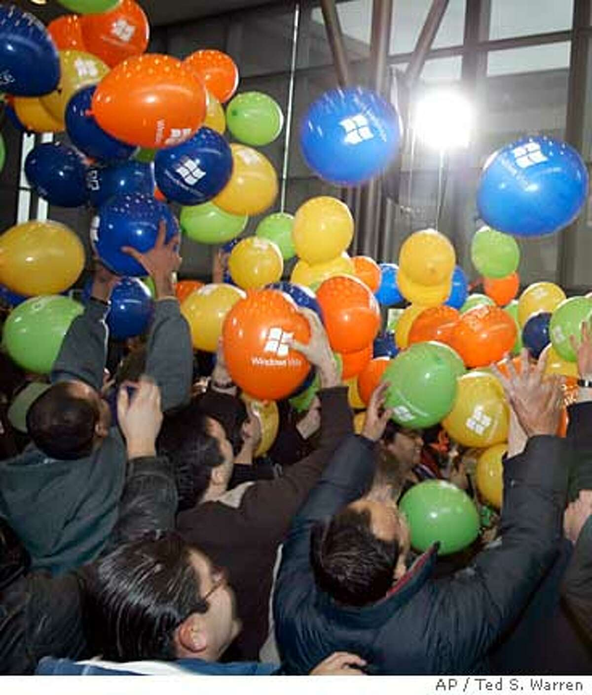 Balloons fall in a Microsoft Corp. cafeteria as employees celebrate the release of Microsoft's Windows Vista computer operating system Monday, Jan. 29, 2007 at the company's headquarters in Redmond, Wash. Vista goes on sale Tuesday. (AP Photo/Ted S. Warren)