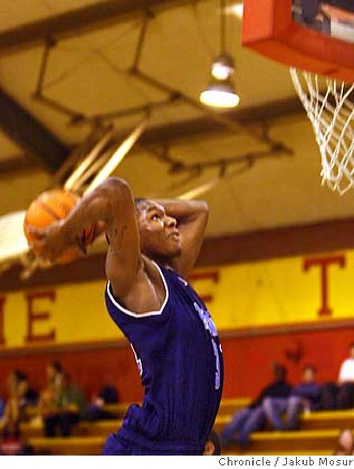 Boys08_04_JMM.JPG  Richmond High's Wendell McKines slam dunks during a game against De Anza High at De Anza High School in El Sobrante.  Event on 2/7/06 in El Sobrante. JAKUB MOSUR / The ChronicleRan on: 02-08-2006  Richmond's Orlando Arnold tries to get past De Anza's Robert Usison. Arnold had only 7 points. MANDATORY CREDIT FOR PHOTOG AND SF CHRONICLE/ -MAGS OUT Photo: JAKUB MOSUR