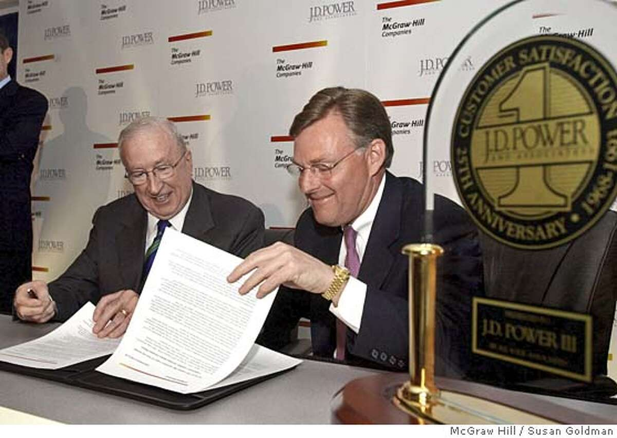 Harold McGraw III, right, chairman, president and chief executive officer of The McGraw-Hill Companies (NYSE: MHP) and J.D. Power III, founder of J.D. Power and Associates, sign an agreement Monday, March 7, 2005 at J.D. Power headquarters in Westlake Village, Calif., announcing the sale of J.D. Power to the New York-based global information company. McGraw said the acquisition will help accelerate J.D. Power's expansion into new markets and Power will remain actively involved in the strategic direction of the operation. Photo/McGraw Hill, Susan Goldman, handout.