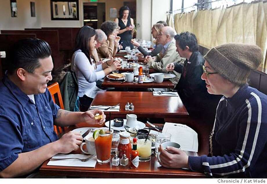 WHATSNEW31_002_KW_.jpg  On Sunday January 28, 2007 (L to R foreground) Thaddeus Roa and Lisa Sexton enjoy Sunday Brunch at Luka's Taproom & Lounge in Oakland on Broadway. In the background (L to R) Jimin Chung, Todd Freter, Tracy Downard, Meredith Broome, Server:Amber Merziotis, Lisa Raymond, Roger Saut, and Sebastian Stuart. Kat Wade/The Chronicle Mandatory Credit for San Francisco Chronicle and photographer, Kat Wade, Mags out Photo: Kat Wade