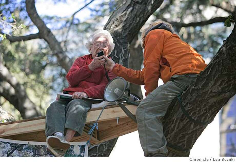 Sylvia McLaughlin, 90, of Berkeley speaks into a bullhorn after climbing a tree in the Oak Grove next to Memorial Stadium.  Shirley Dean, Betty Olds and Sylvia McLaughlin, three old ladies who are active in Berkeley politics, will be climbing the trees with the tree-sitters next to Memorial Stadium on Monsday, January 22, 2007. Photo by Lea Suzuki/The San Francisco Chronicle  Photo taken on 1/22/07, in Berkeley, CA. **(themselves) cq. Photo: Lea Suzuki