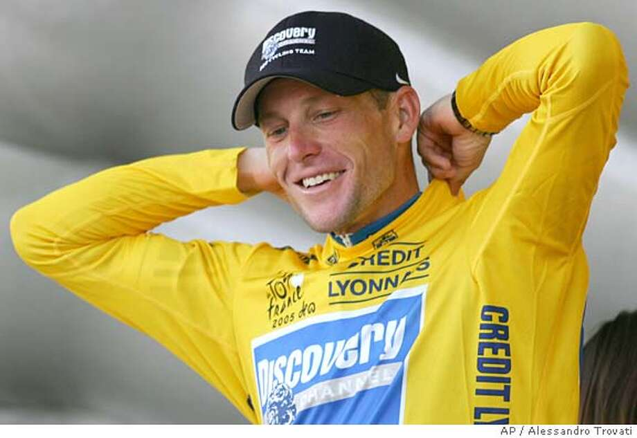 Overall leader Lance Armstrong, of Austin, Texas, pulls on the yellow jersey on the podium after winning the 20th stage of the Tour de France cycling race, a 55.5-kilometer (34.5-mile) individual time trial looping around north of Saint-Etienne, central France, Saturday, July 23, 2005. (AP Photo/Alessandro Trovati) Photo: ALESSANDRO TROVATI