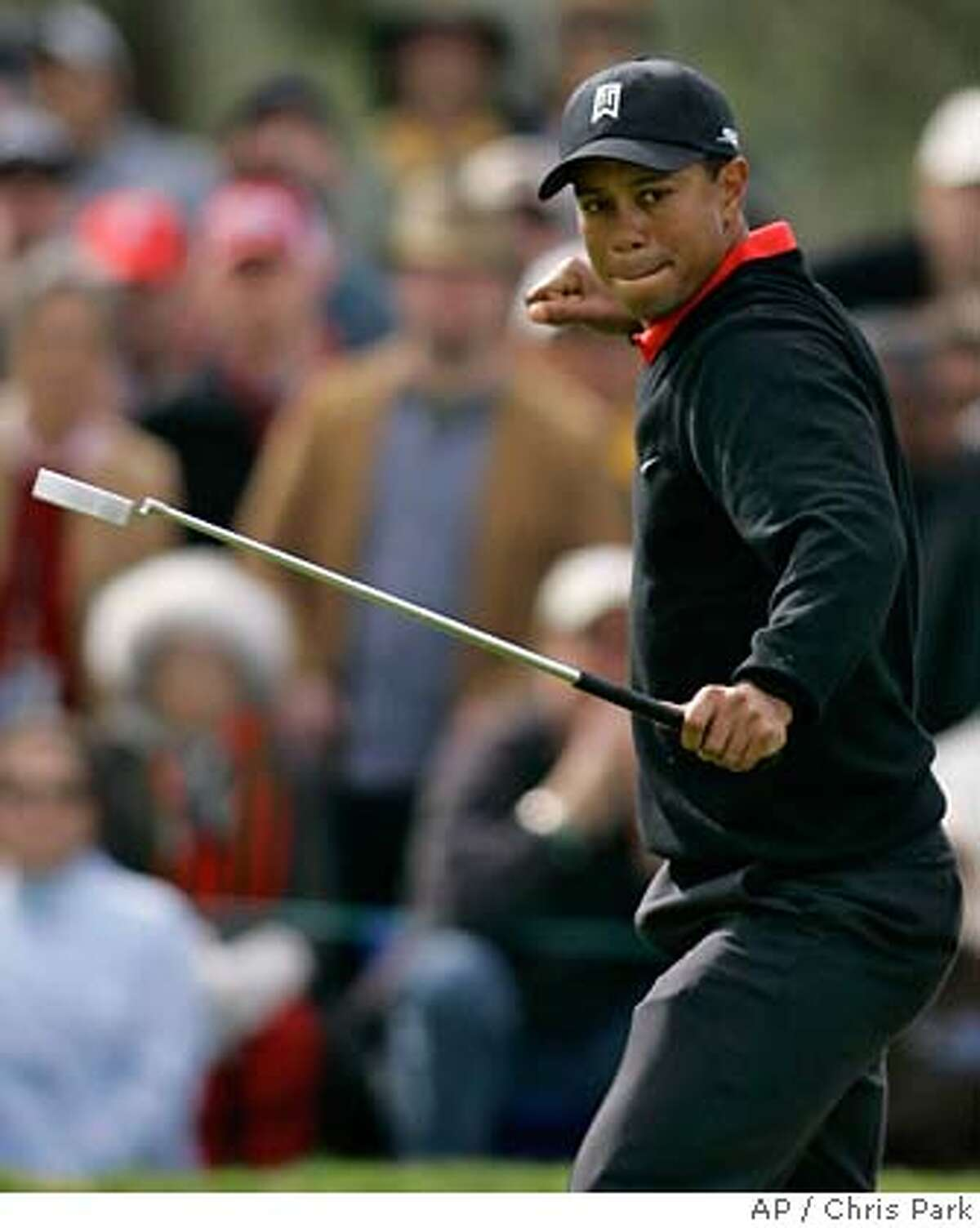 Tiger Woods reacts as he makes an eagle putt on the ninth hole which temporarily tied him for lead during the final round of the Buick Invitational golf tournament in San Diego, Sunday, January 28, 2007. (AP Photo/Chris Park)