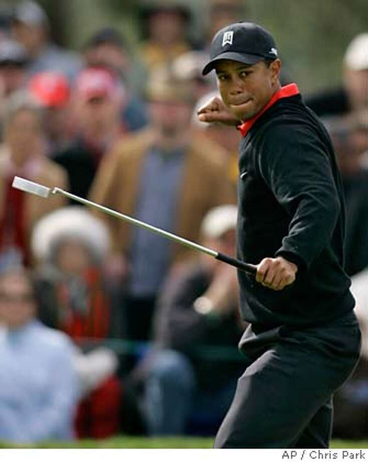 Tiger Woods reacts as he makes an eagle putt on the ninth hole which temporarily tied him for lead during the final round of the Buick Invitational golf tournament in San Diego, Sunday, January 28, 2007. (AP Photo/Chris Park) Photo: Chris Park