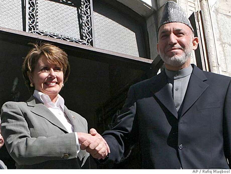 Nancy Pelosi, left, the leader of the U.S. House of Representatives shakes hands with Afghan President Hamid Karzai at the residential palace in Kabul, Afghanistan, Sunday, Jan. 28, 2007. Pelosi ate breakfast with soldiers from California on Sunday and met briefly with top military leaders at the largest U.S. base in Afghanistan, an official said. (AP Photo/Rafiq Maqbool) Photo: RAFIQ MAQBOOL