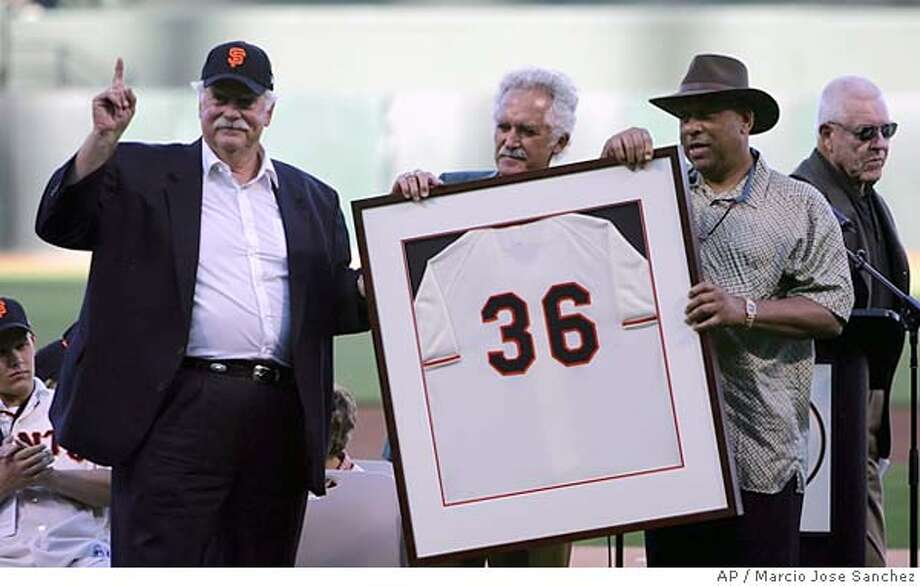 Former San Francisco Giants player Gaylord Perry, second from left, is joined by former teammates Mike McCormick, midde, and Orlando Cepeda in a ceremony retiring Perry's number before the start of a game against the Florida Marlins on Saturday, July 23, 2005 in San Francisco, Calif. (AP Photo/Marcio Jose Sanchez) Photo: MARCIO JOSE SANCHEZ