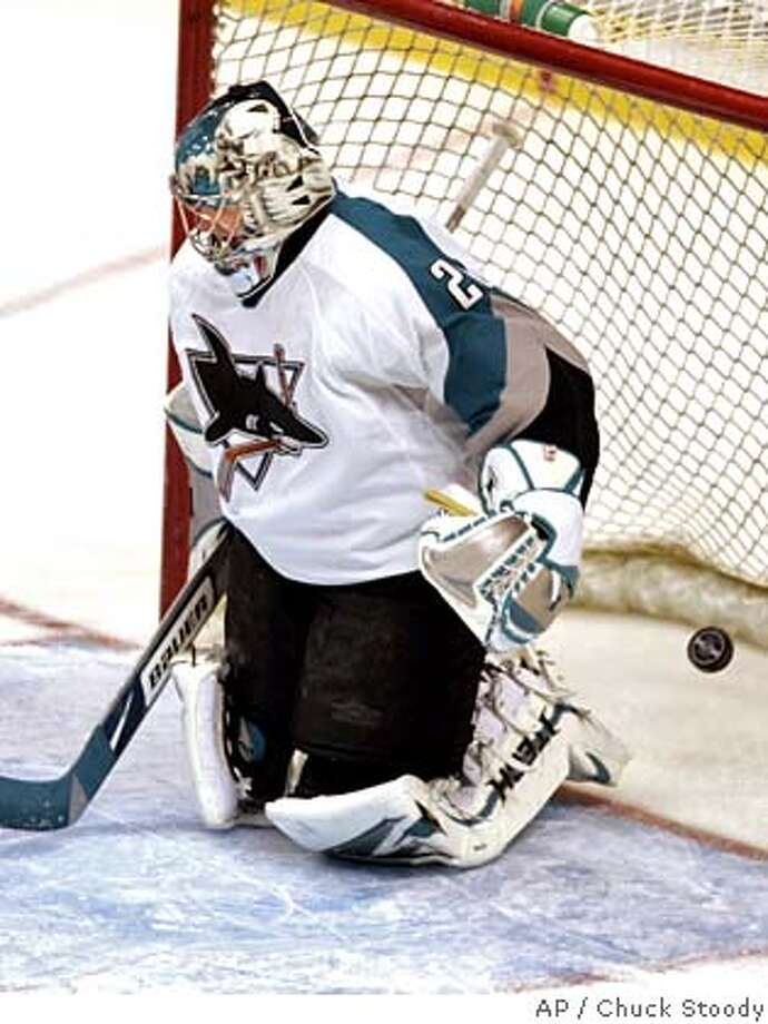 San Jose Sharks goalie Evgeni Nabokov fails to make the save as the Vancouver Canucks tie the game 1-1 during the second period of NHL action in Vancouver Sunday January 28, 2007. The goal was scored by Vancouver Canuck Taylor Pyatt. (AP Photo/Chuck Stoody, CP) Photo: CHUCK STOODY