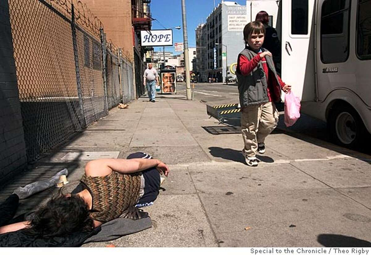 Daragh Hughes (7), passes a homeless woman passed out on Turk St. Photo by Theo Rigby/Special to The Chronicle -ONE TIME USE ONLY-
