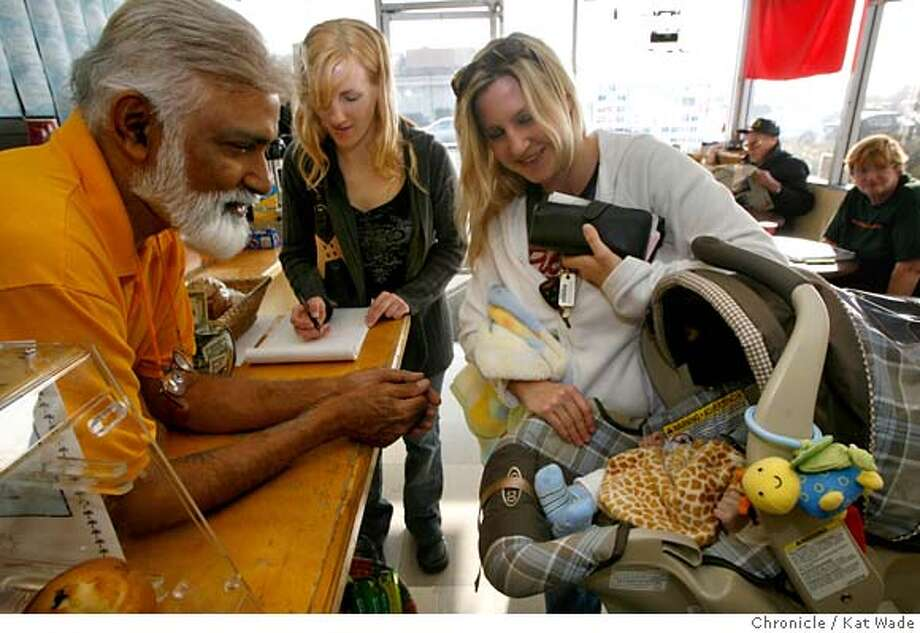 COFFEESHOP29_046_KW_.jpg  On Thursday January 25, 2007 checking out the new baby, (L to R) Raman Bechar, owner of Coastside Coffee and Chai, a Half Moon Bay institution for thirteen years, Bree Tiura,(signing petition) Libby Garcia and her son Dylan Garcia, 2 mos. in the shop may soon be replaced by a Peet's Coffee. The issue is on the agenda for the next city council meeting. BACKGROUND (L to R) Ed Souter and Kathy Rehm. Kat Wade/The Chronicle Mandatory Credit for San Francisco Chronicle and photographer, Kat Wade, Mags out Photo: Kat Wade