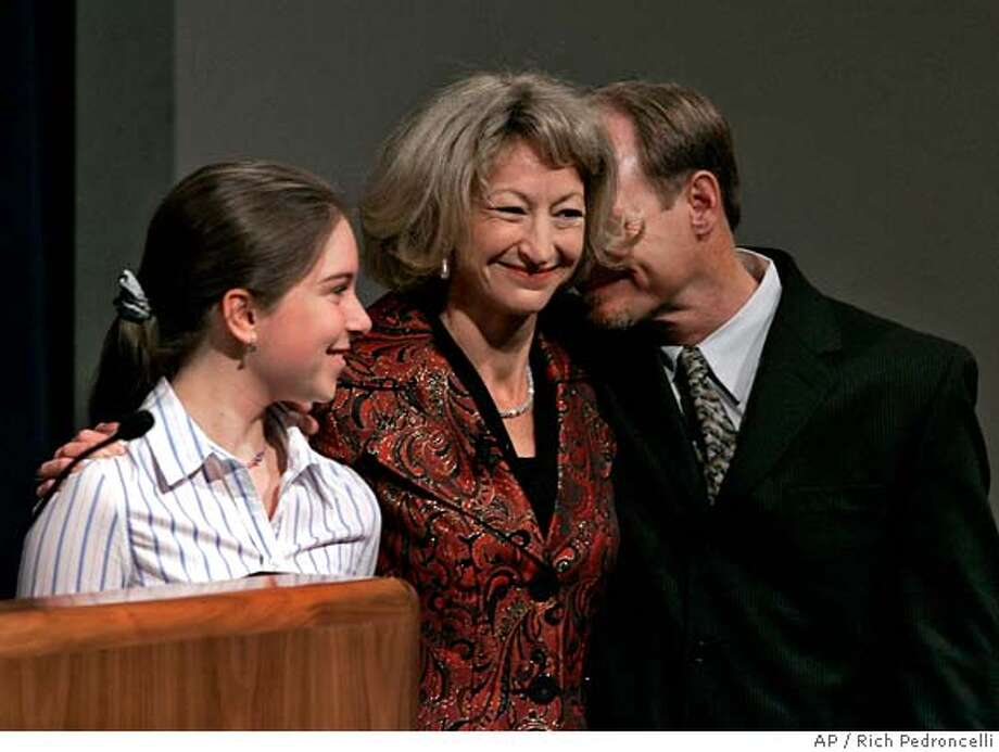 Former State Sen. Debra Bowen, D-Redondo Beach, center smiles as she is hugged by her step-daughter Nora Miller Nechodom, left, and husband Mark Nechodom, right after she was sworn in as Secretary of State in Sacramento, Calif., Monday, Jan. 8, 2007. (AP Photo/Rich Pedroncelli) Photo: Rich Pedroncelli