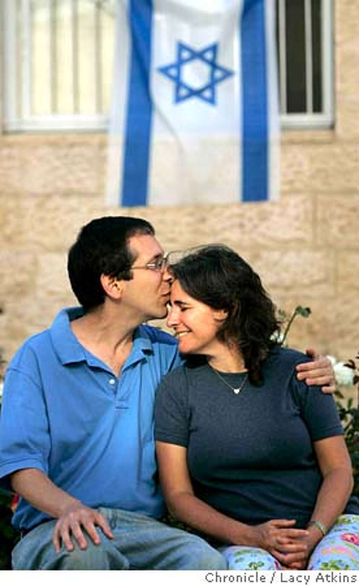 Brian Blum with his wife Jody, at home in Jerusalem, June 16, 2005, in Israel. Brian is from Berkeley and followed his roots to Israel. He's just a normal guy with the exception that his cousin, Marla Bennett was killed in a cafe by a suicide bomber and a bus blow-up along his jogging route moments before he was there. Photographer Lacy Atkins