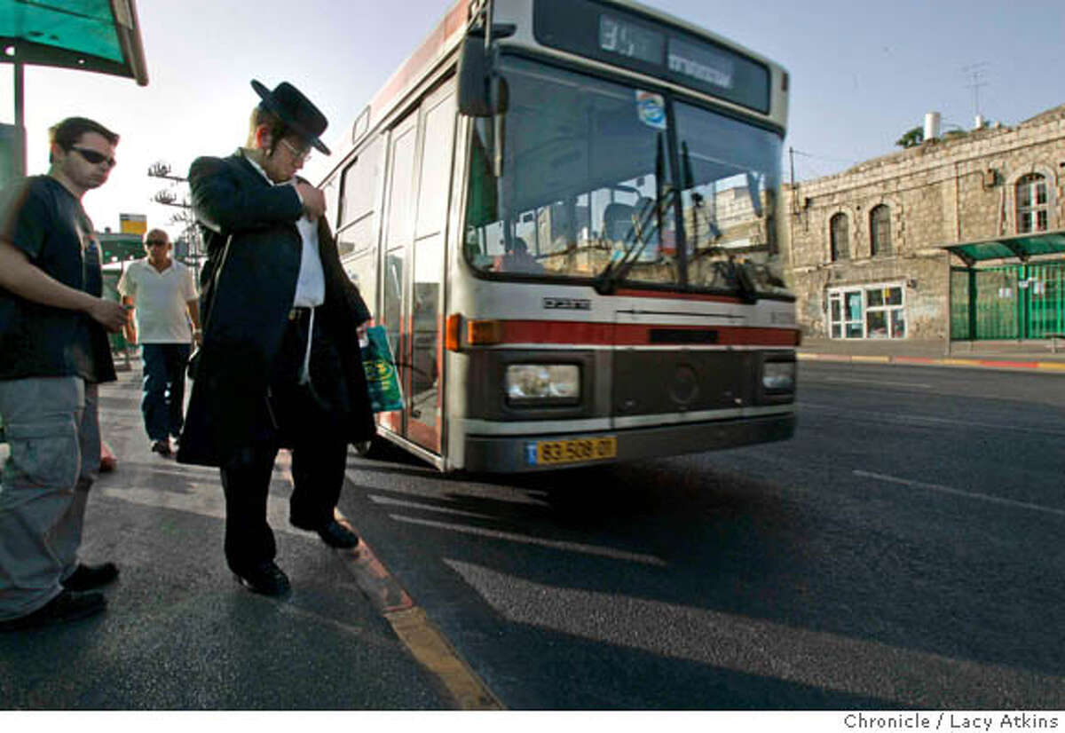 People on their morning commute on the bus line from Emek Refaim / King David Street in the German Colony to town in Jerusalem, June 16, 2005, in Israel. This was the bus line which ran along Brian Blum's jogging route, where a suicide bomber blow up the bus. Photographer Lacy Atkins