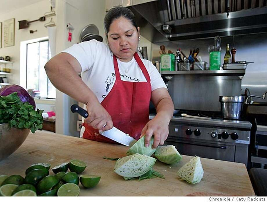 """SHOWN: Maria Elena Plancarte prepares fresh cabbage salsa in the kitchen of the Boonville General Store. Story about Mexican women in the Anderson Valley whose receipes appear in the book """"Secrets of Salsa"""" cookbook; these women are helping mobilize their community to produce drops locally to sustain their endeavor year-around. The women hope to expand, and to prepare tamales, organic corn tortillas, etc. . Reporter is Laramie Trevino for Home and Garden. Photo taken on 7/11/05, in Boonville, CA.  By Katy Raddatz / The San Francisco Chronicle Photo: Katy Raddatz"""