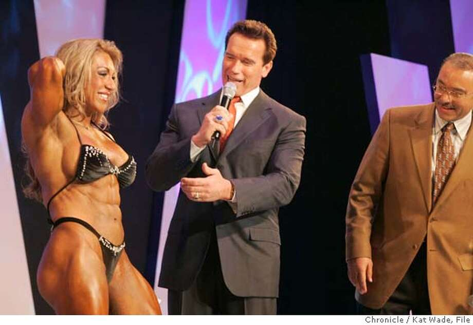 "OHIOWOMEN_539_KW.jpg  Schwarzenegger comment on the ""ripped abs"" of the heavy weight division winner, Yaxeni Oriquen, from Venezuela, who also took the overall award, as she accepts her first place award from California Governor Arnold Schwarzenegger on stage with Columbus Mayor, Michael B. Coleman. The Heavy weight division contestants competed at the Veterans Memorial Hall at the 2005 Arnold Classic during Arnold's Fitness Weekend on 3/4/05 in Columbus, Ohio. Kat Wade/ The Chronicle Ran on: 03-06-2005  Gov. Arnold Schwarzenegger praises female heavyweight champion Yaxeni Oriquen of Venezuela along with Columbus Mayor Michael B. Coleman (right) on Friday. Ran on: 03-06-2005  Gov. Arnold Schwarzenegger praises female heavyweight champion Yaxeni Oriquen from Venezuela as Columbus Mayor Michael B. Coleman looks on at the Arnold Classic in Columbus, Ohio. MANDATORY CREDIT FOR PHOTOG AND SF CHRONICLE/ -MAGS OUT Photo: Kat Wade"
