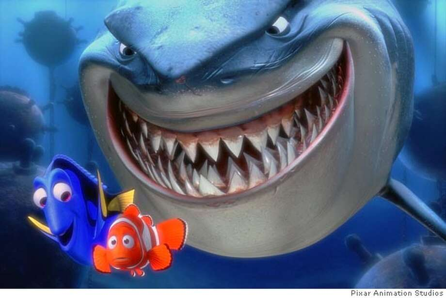 "** FILE ** Dory, lower left, and Marlin, lower right, face an ocean full of perils in their efforts to rescue Nemo, including a close encounter with an unusual group of great white sharks, in this scene from Pixar Animation Studios ""Finding Nemo,"" in this undated promotional photo. (AP Photo/Pixar Animation Studios) Ran on: 08-06-2004  Dory (lower left), and Marlin (lower right) face an ocean full of perils, such as great white sharks, in &quo;Finding Nemo.'' HANDOUT"
