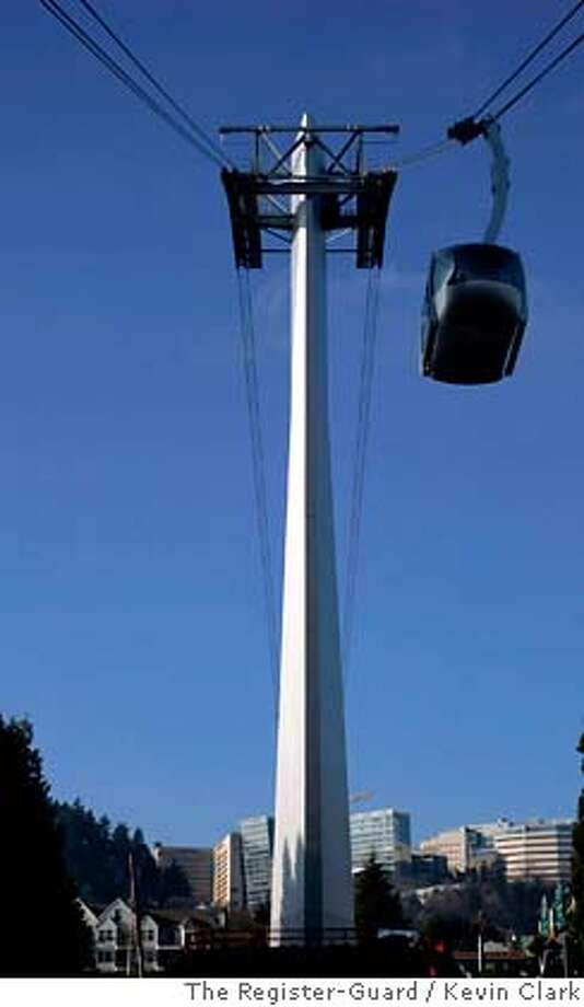 ** ADVANCE FOR MONDAY, JAN. 15 ** The $57 million Aerial Tram in Portland, Ore,, shown Dec. 28, 2006, takes riders to the Oregon Health & Science University's main campus on Marquam Hill. The ride takes two-hundred seconds and offers panoramic views of the city and mountains from as high as 500 feet. (AP Photo/The Register-Guard, Kevin Clark) ** MAGS OUT, ** ADVANCE FOR MONDAY, JAN. 15. MAGS OUT, Photo: Kevin Clark