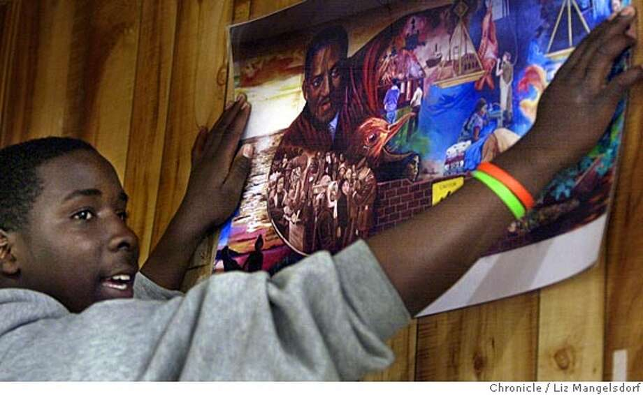 Event on 7/18/05 in San Francisco.  Greg Claybron, 16, puts up on of the pictures in the supersave.  Kids from Thurgood Marshall High redecorate Super Save on 3rd Street, taking down liquro ads and putting up positive pictures.  Liz Mangelsdorf / The Chronicle Photo: Liz Mangelsdorf