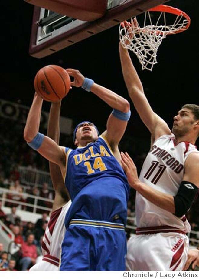 Stanfrod's Brook Lopez stops UCLA Lorenzzo Mata from scoring in the second half of the game, Sunday Jan. 28, 2007, in Stanford, Ca. Stanford rated 4th hosts UCLA rated 1st, Janurady 28, 2007, in Stanford, Ca. (Lacy Atkins/The Chronicle) Ran on: 01-29-2007  Brook Lopez turns away UCLA's Lorenzo Mata during the second half.  Ran on: 01-29-2007  Brook Lopez turns away UCLA's Lorenzo Mata during the second half. Photo: Lacy Atkins